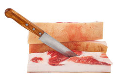 Piece of lard with knife Royalty Free Stock Photography