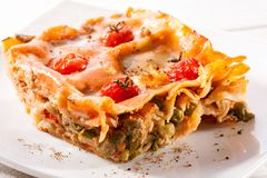 Piece of lasagna close-up on white plate Royalty Free Stock Images