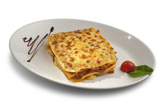 Piece of lasagna with meat. In a white bowl stock photography