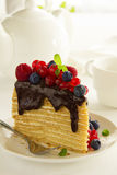 Piece of layer cake with chocolate sauce Royalty Free Stock Photos