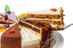Piece of layer cake with nuts Royalty Free Stock Photos