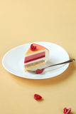 Piece of Layered Vanilla, Raspberry, Peach Mousse Cake, Royalty Free Stock Photo