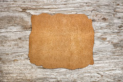 Piece of leather on the old wood. En background Royalty Free Stock Photography