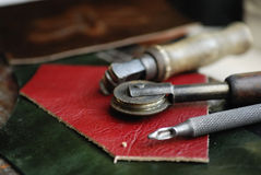 Piece of leather and some tools Stock Photography