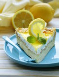 Piece of lemon cake tart decorated with fresh lemon Stock Image
