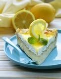 Piece of lemon cake tart decorated with fresh lemon Stock Image