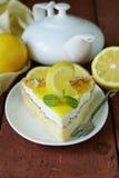 Piece of lemon cake tart decorated with fresh lemon Royalty Free Stock Image