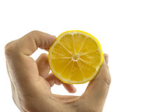 Piece of lemon in hand Stock Photo