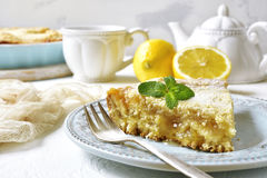 Piece of lemon pie for a breakfast. Piece of lemon pie for a breakfast on a light background Stock Photography