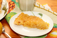 Piece of lemon pie. On a white plate royalty free stock photography
