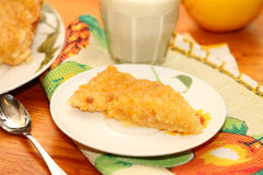 Piece of lemon pie. On a white plate Stock Image
