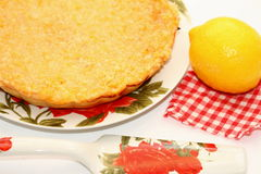 Piece of lemon pie. On a white plate Royalty Free Stock Image