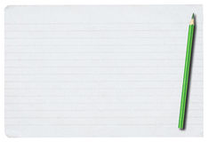 Piece of lined paper and pencil on white. Piece of lined paper and pencil isolated on pure white background Royalty Free Stock Image
