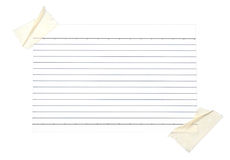 Piece of lined paper stuck with tape Royalty Free Stock Images