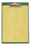 Piece of lined paper stuck to a clipboard Royalty Free Stock Photography