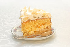 Piece of mango cake with white whipped cream and scattered almon Stock Images