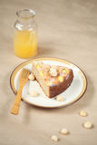 Piece of Mango Macadamia Cake on a plate. Royalty Free Stock Photos