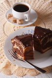 Piece of marble cake with chocolate and coffee on the table. ver Royalty Free Stock Images