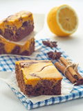 Piece of marble chocolate brownies with pumpkin. Thanksgiving treat. Freshly baked homemade brownie. Selective focus on the front. Vertical Stock Photos