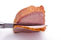 Piece of meat. Cutting a slice of ham Royalty Free Stock Photos