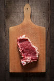 Piece of meat on chopping board Royalty Free Stock Image