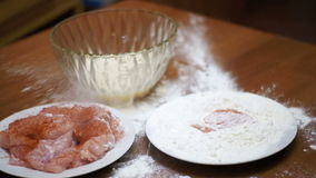 Piece of Meat Falls on a Plate of Flour in Home Kitchen. Slow Motion stock video footage