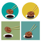Piece of meat is holding with chopsticks and sauce Stock Photos