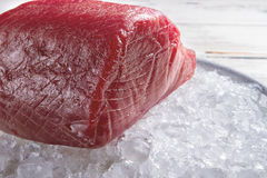 Piece of meat on ice. Royalty Free Stock Images