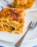 Piece of meat lasagna with mushrooms, cutlery, Italian food Royalty Free Stock Photos