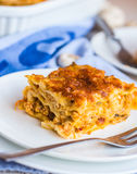 Piece of meat lasagna with mushrooms, cutlery, Italian food Stock Photo
