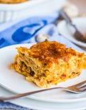 Piece of meat lasagna with mushrooms, cutlery, Italian food Stock Photo