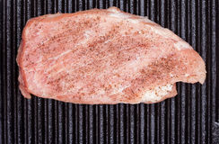 Piece of meat in the pan closeup Royalty Free Stock Photos