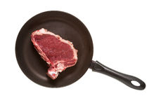 Piece of meat in pan. On white background Stock Photos