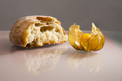 Piece of mediterranean bread with olives and Physalis peruviana fruit Royalty Free Stock Photo
