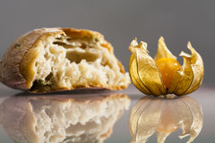 Piece of mediterranean bread with olives and Physalis peruviana fruit Stock Images
