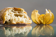 Piece of mediterranean bread with olives and Physalis peruviana fruit Royalty Free Stock Photos