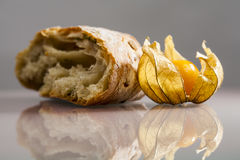 Piece of mediterranean bread with olives and Physalis peruviana fruit Royalty Free Stock Image