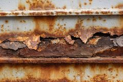 A piece of metal with corrosion. Is close stock photography