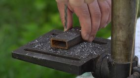The piece of metal is drilled through. stock footage