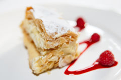 Piece of mille-feuille cake on porcelain plate Stock Image