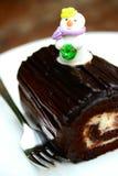 Piece of mini chocolate log cake Royalty Free Stock Images