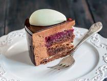 Piece of modern mousse cake with chocolate glaze. Stock Photos
