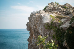 Piece of the mountain on the background of the sea Stock Photography