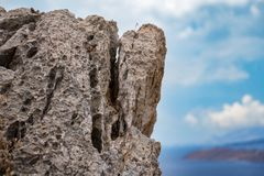 A piece of mountain in Greece against a blue background royalty free stock photography