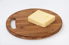 Piece of mozzarella cheese on a kitchen wooden board Royalty Free Stock Image