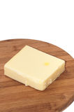 Piece of mozzarella cheese on a kitchen wooden board Stock Images