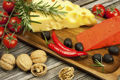 Piece of natural cheese on a wooden board Royalty Free Stock Photos