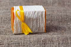 Piece of natural soap with yellow ribbon Stock Photo