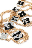 Piece of necklace chain with black flowers Stock Photos