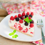 A Piece of No-bake Raspberry Cheesecake. A Piece of No-bake Fresh Raspberry Cheesecake with Red and Black Raspberries and Melissa, Summer Cake, square Stock Photo